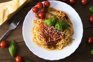 spaghetti bolognese with tomato sauce, cheese and basil © carballo