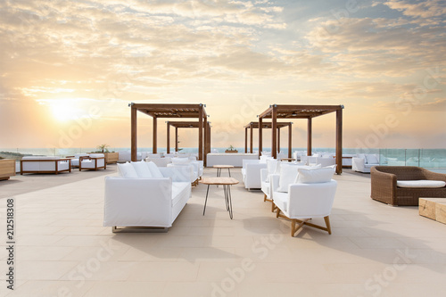 Leinwanddruck Bild Sunset, sea  hotel resort, cafe bar