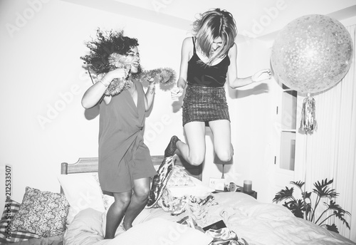Girls jumping on the bed...