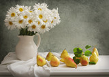 still life with bouquet of daisy flowers and fresh pears