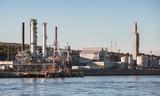 Modern oil plant, coastal industrial landscape - 212539925