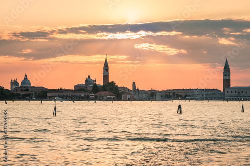 sunset over Venetian lagoon with Venice skyline in background