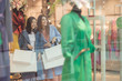 Attractive young women with shopping bags - 212557989