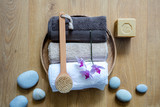 brush, towels, orchids and eco-friendly soap over zen stones - 212562379