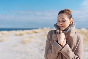 Attractive woman on a beach in cold weather