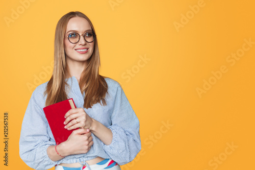 Woman in glasses with book © kegfire