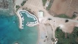 Spinning aerial drone shot of a bay with boats docked in Ayia Napa Cyprus - 212582384