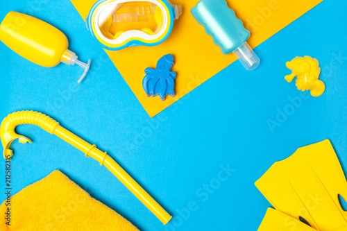 Foto Murales Top view of a beach essentials composition of plastic toys and snorkling equipment