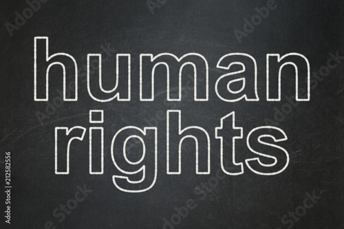 Naklejka Political concept: text Human Rights on Black chalkboard background