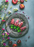 Homemade red berries fruits ice cream or Popsicle in plate on kitchen table background with garden flowers and ingredients, top view. Seasonal healthy organic food and eating concept. Food still life - 212586775