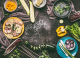 Preparation of Chicken with vegetables cooking on rustic background with fresh ingredients , plates, bowls and kitchen tools, top view, flat lay.  Food, eating and cooking concept , frame - 212589149