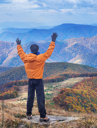Hiker enjoying the trip in the top of mountain. - 212590307