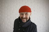 guy with a mustache in a red knitted hat - 212590510