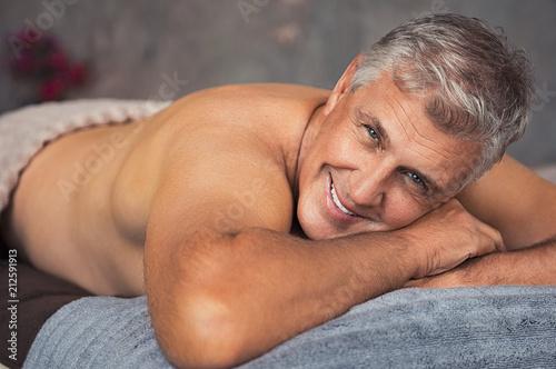 Leinwanddruck Bild Senior man relaxing at spa