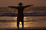 man on the beach in india, ocean, coast, vacation. rest on goa - 212593336