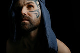 tattoo on the face,  man with a tattoo,  brutal bearded guy, studio portrait of a man - 212593399