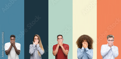 Group of people over vintage colors background shocked covering mouth with hands for mistake. Secret concept.