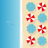Aerial view of sea beach with beach umbrellas