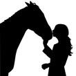 Girl kissing a horse