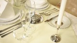 Rules of table setting in the restaurant. Cutlery, plates and candles. - 212605587