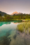 Beautiful sunrise over emerald green water in Zelenci spring - 212607922