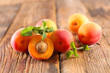 fresh apricot on wood background