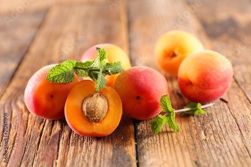 fresh apricot on wood background - 212611908