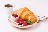 Coffee, fresh croissant with jam and berries for breakfast - 212613728