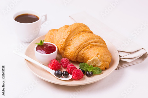 Poster Coffee, fresh croissant with jam and berries for breakfast