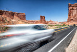 Fast moving car entering Arches National Park, Utah - USA - 212621520
