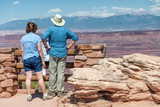 Couple of tourists enjoying the view of beautiful canyon - 212622924