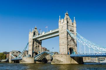 Tower bridge raised England flags