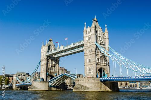 Tower bridge raised England flags - 212623540