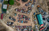 Overhead aerial view of cars wreckage gathered in a countryside parking - 212624337