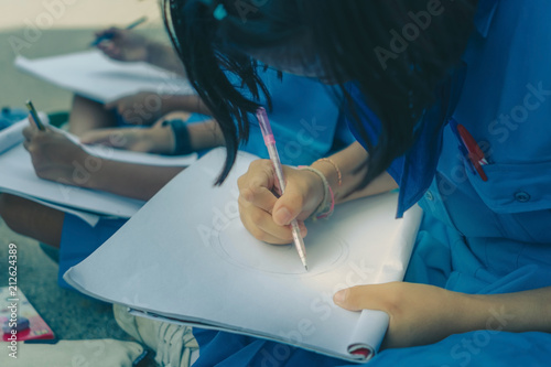 Students try to drawing Thai motifs from Thai architecture in th