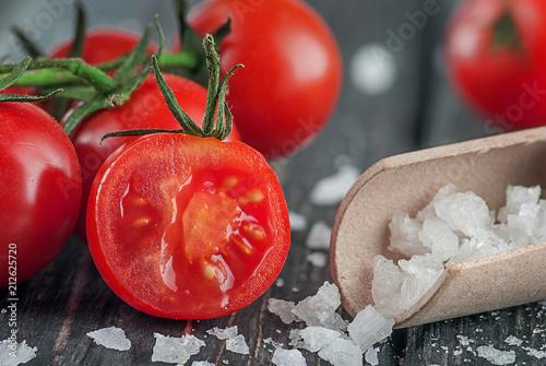 Fotobehang Kersen Cherry tomatoes and salt