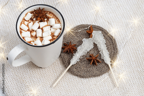 Fotobehang Chocolade Hot chocolate or cacao with marshmallows in white cup with christmas lights. Winter holiday food. Sweet hot beverage. Copy space.
