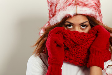 Woman with red winter clothing.
