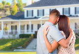 Affectionate Military Couple Looking at Beautiful New House - 212640903