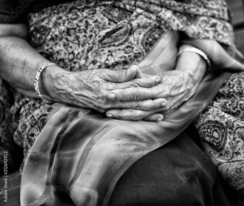 Wrinkled hands of Indian woman, dressed in traditional sari