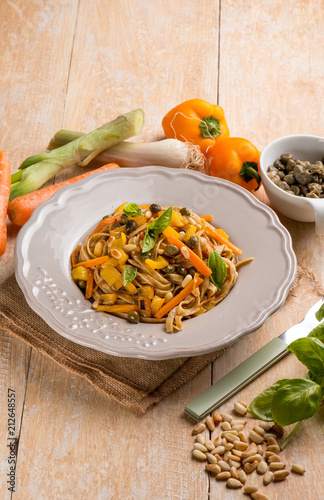 tagliatelle with capsicum capers pinenuts an carrots - 212648557