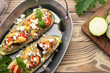 Zucchini boat filled with ground beef, mushroom, tomato sauce and parmesan cheese. - 212656948