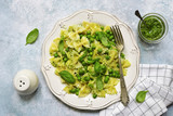 Farfalle pasta with pesto sauce and green pea.Top view. - 212664114