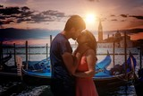 Young couple in love is kissing in Venice in Italy. - 212668101