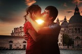Young couple in love is kissing in Venice in Italy. - 212668111