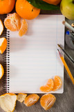 Notebook surrounded by fruit