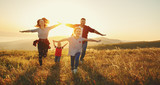 Happy family: mother, father, children son and daughter on sunset - 212673990