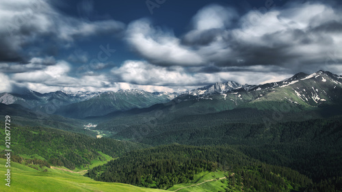 Fotobehang Nachtblauw Beautiful nature landscape of mountains with snow and green forest