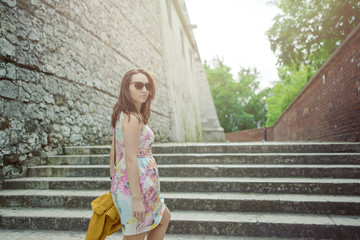 Beautiful girl during sightseeing old castle in Cracow, Wawel.