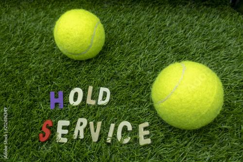 Aluminium Tennis Tennis ball with tennis wording term on green grass
